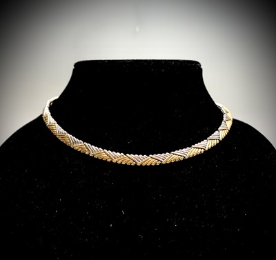 Lot 258 - A contemporary 18ct two-colour gold weave...