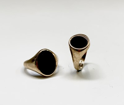 Lot 159 - Two 9ct gold signet rings each set with black...