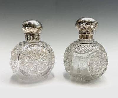Lot 1047 - Two large spherical glass toilet bottles each...
