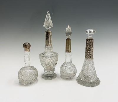 Lot 1007 - Four cut glass tall toilet bottles each with...