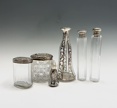 Lot 1051 - Four cut glass toilet jars each with silver...