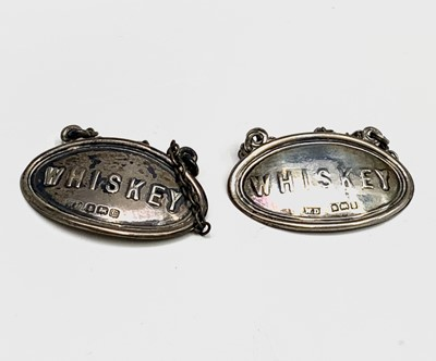 Lot 1005 - A pair of silver Whiskey noggin labels...