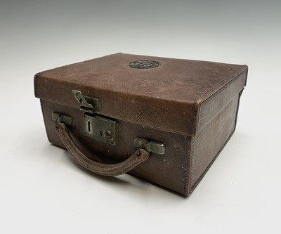 Lot 1071 - A child's leather toilet case with most of...