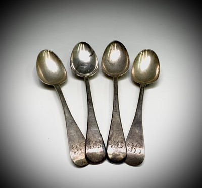 Lot 1082 - Four Georgian Old English pattern table spoons...