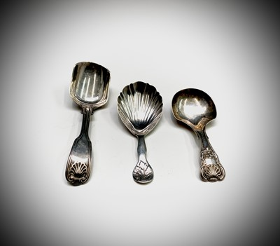 Lot 1044 - Three Victorian silver caddy spoons: Henry...
