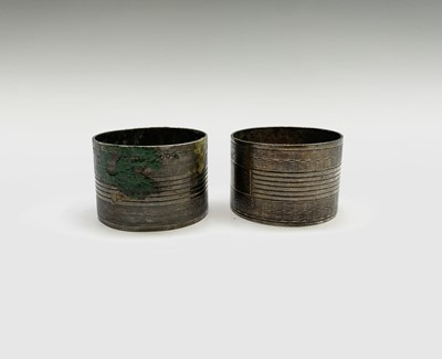 Lot 1025 - A pair of silver engine turned napkin rings...
