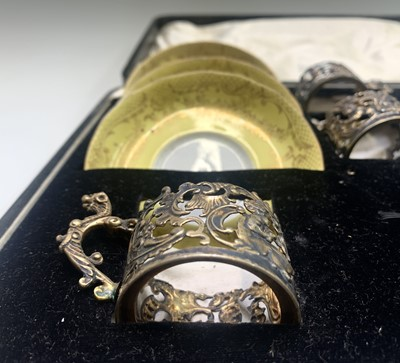 Lot 1009 - Five late Victorian silver coffee cup holders...