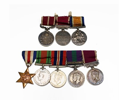 Lot 210 - A Meritorious service family group to the...