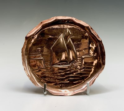 Lot 3 - A Newlyn copper small circular tray, repousse...