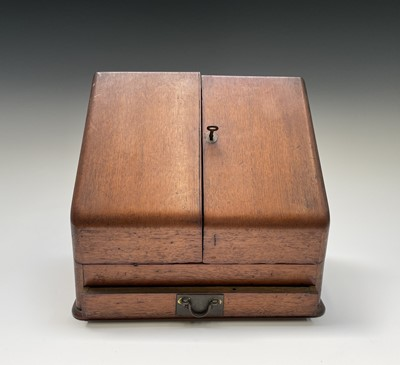 Lot 22 - An oak stationery cabinet, 1920s, with two...