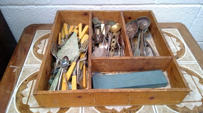 Lot 1 - A cutlery tray with miscellaneous stainless...