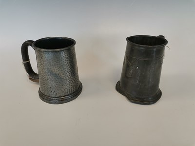 Lot 11 - Two pewter tankards.