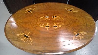 Lot 50 - A Victorian walnut breakfast table top, on...