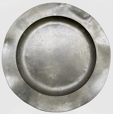 Lot 60 - A pewter charger, 19th century, of circular...