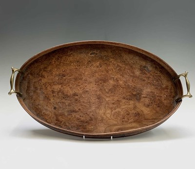 Lot 13 - A burr ash twin handled oval tray, early 20th...
