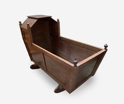 Lot 53 - An elm crib, early 20th century, with a...