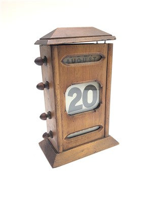Lot 24-An early 20th century oak perpetual desk calendar,...