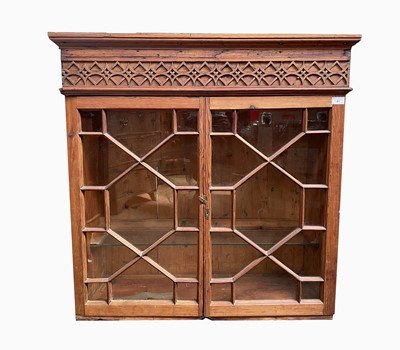 Lot 41 - A pitch pine hanging display cupboard, late...