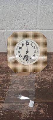 Lot 47 - A ceramic tile-effect retro kitchen wall clock.