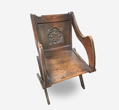 Lot 44 - A Glastonbury oak armchair, late 19th century,...