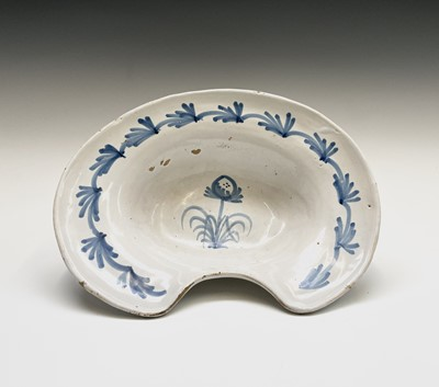 Lot 93 - A tin glazed barber's bowl, 18th century,...
