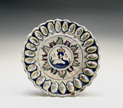 Lot 29 - An English delft polychrome decorated lobed...