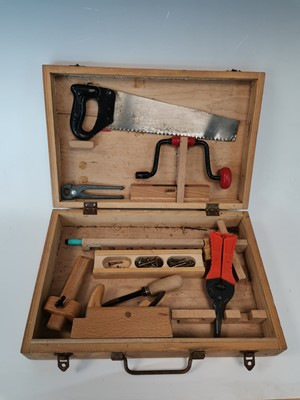 Lot 6 - A wooden tool kit box with tools.