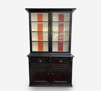 Lot 83 - A Victorian pine black painted bookcase, with...