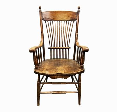 Lot 84 - A near pair of American oak armchairs, circa...