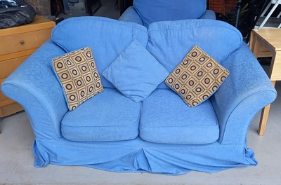Lot 32 - A blue upholstered two person sofa with...