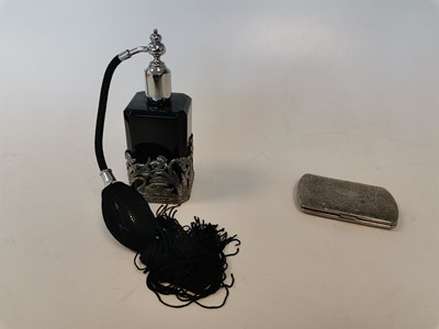 Lot 15 - A black perfume atomizer and an antique...