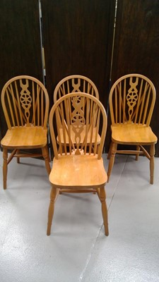 Lot 49 - Four stick back chairs.