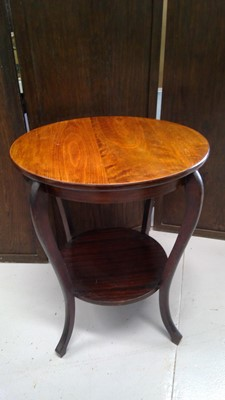 Lot 52 - A mahogany two tier circular table, height...