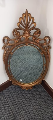 Lot 68 - An ornate American Syroco mirror with gold...