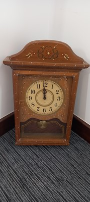 Lot 70 - A wooden battery-powered Vanguard wall clock