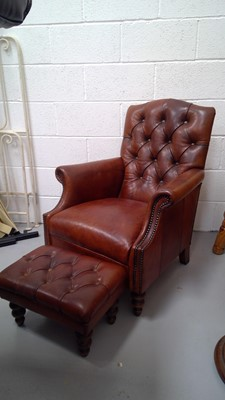 Lot 17 - A good quality leather button back armchair...
