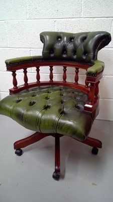 Lot 1 - A Centurion furniture green leather captain's...