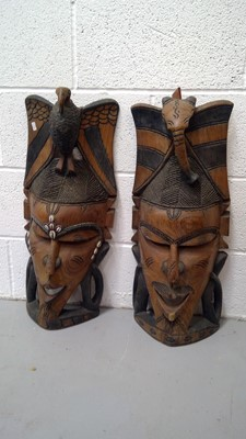 Lot 15 - A pair of tropical hardwood carved masks,...
