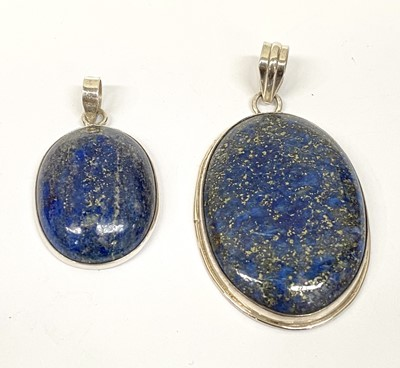 Lot 4 - Two silver and lapis pendants, the largest...