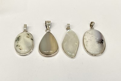 Lot 5 - Four pendants each silver mounted and set with...