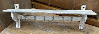 Lot 16 - A distressed coat rack and shelf.
