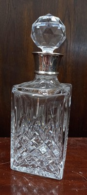 Lot 3 - A large heavy glass decanter with solid silver...