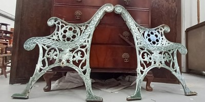 Lot 9 - A pair of attractive cast iron bench ends with...