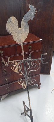 Lot 10 - A wrought-iron weather vane with a hen...