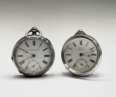 Lot 43 - Two silver key wind pocket watches The first...