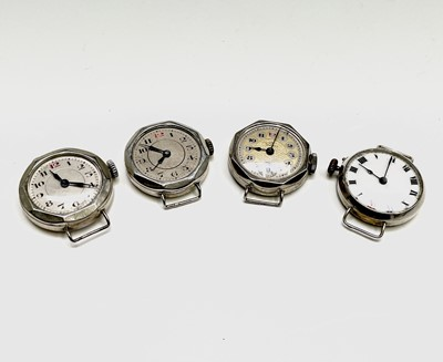 Lot 29B - Four ladies silver cased trench style watches.