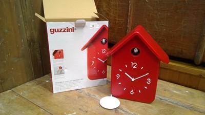 Lot 13 - A guzzini cuckoo clock and pendulum boxed.