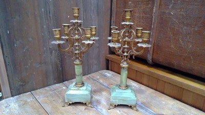 Lot 15 - A pair of French onyx and brass five branch...