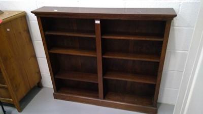 Lot 17 - A twin bay open oak bookcase height 107cm...