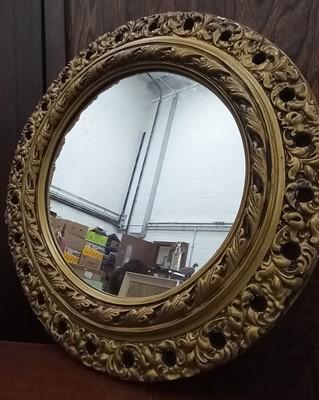 Lot 20 - A circular plaster gilt wall mirror, 42cm in...